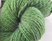 Hand spun yarn skein green with gold thread; color Bryophyta