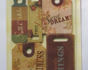 A set of 5 chipboard tags
