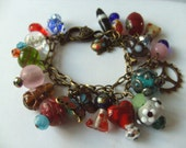Charm bracelet, Bohemian, Indian glass, bronze, mix colour, by NewellJewels on etsy