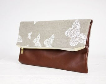 Brown genuine leather and canvas clutch