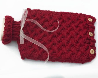 Hot water bottle cover and two litre  hot water bottle in red included