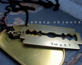 SHARP OBJECT - mens simple aged brass stamped tag & large metalwork razor blade charm with black sealed link chain NECKLACE