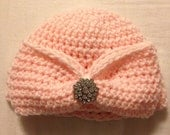 Pink hat with bow and rhinestone button accent
