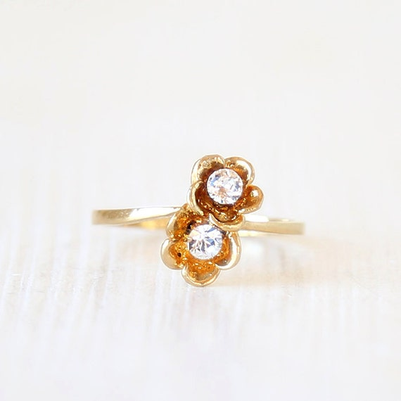 dainty vintage flower engagement ring by