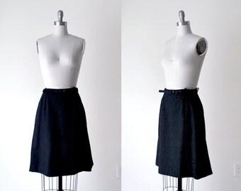 60 black wool skirt. 60's italian wool. embroidered. small skirt. belt. 1960 black skirt.