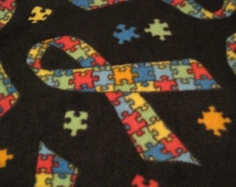 Autism Logo Puzzle Pieces in a Ribbon with Green Couch Throw - Ready to Ship Now