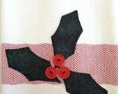 Soft white dish towel with wide red stripe holly appliqué button berries