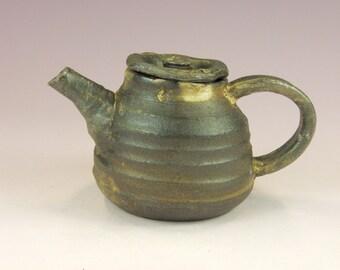 Small wheel  thrown stoneware teapot holds 20oz.