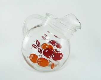 Vintage glass tilt ball fruit juice pitcher, red and orange kitchen decor