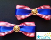 Red, white, and blue hair bows with gold anchors. Portion of sale goes to charity.
