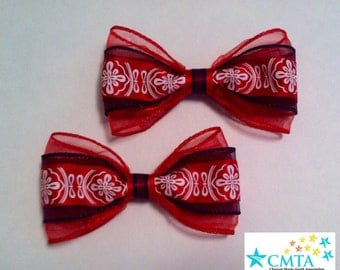 Red, black, and white hair bows. Portion of sale goes to charity.