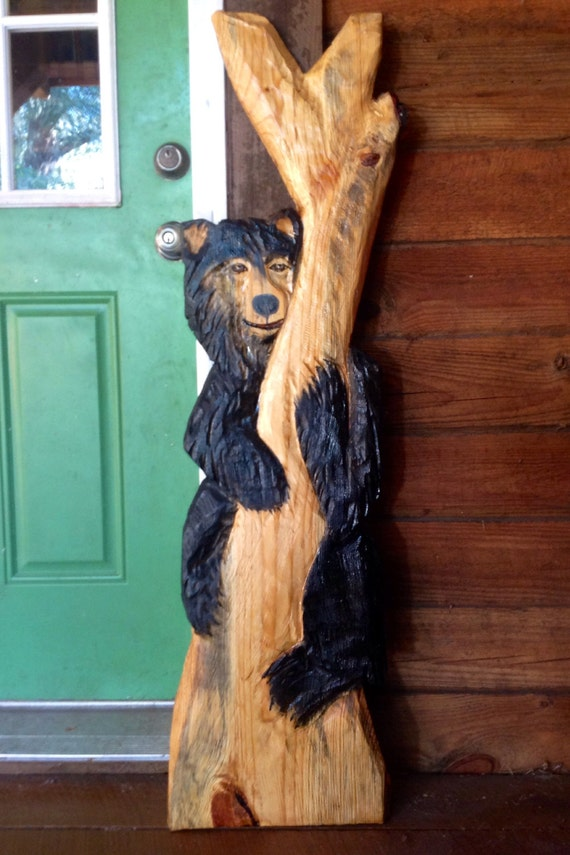 Black bear in tree chainsaw carving wooden by oceanarts