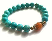 Turquoise Stretch Bracelet With Semi-Precious Magnesite Gemstones, A Faceted Carnelian Gemstone and Antiqued Brass Accents