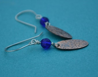 Mixed Metal Sterling Silver and Copper Roller Embossed Earrings with a Cobalt Blue Glass Bead