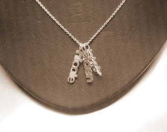 names  necklace . 3 names.  Rhodium  plated .