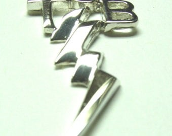 TCB  necklace   with a chain  Rhodium  plated .