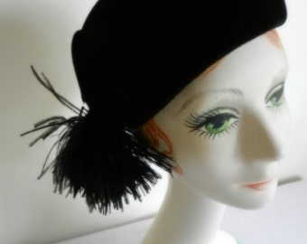 Black Velour Felt Hat with Black Feather Poof by Lisette, sold at Wolf & Dessauer of Fort Wayne, IN