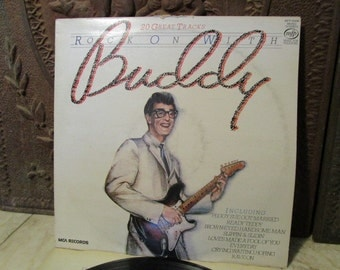 """Vintage 1980, """"Buddy Holly"""" album with cover labelled""""Rock on with Buddy!"""