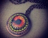 Orange Glass Eye Locket with olivine rhinestone on antique copper-tone locket