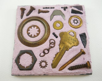screws, rings and keys: small found object mosaic on 4 inch slate tile, rusty hardware bits, lavender grout