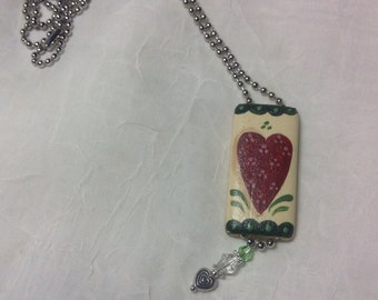 Handpainted bamboo pendant with a ball chain
