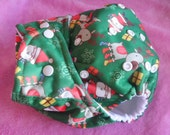 SassyCloth one size pocket diaper with Christmas Santa and reindeer on green PUL print. Made to order.
