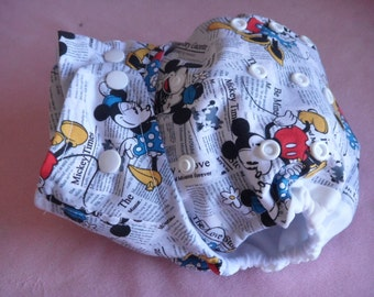 SassyCloth one size pocket diaper with Mickey Mouse all over newspaper cotton print. Made to order.
