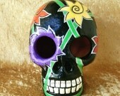 """Handpainted Clay Skull, """"Midnight Garden"""".  Black with vibrant red, yellow, purple flowers.  Day of the Dead art."""