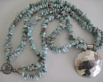 Double strands of larimar with a sterling silver hammered round pendant necklace