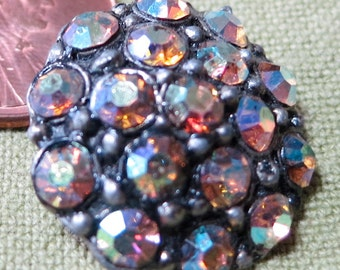 """Lovely iridescent crystal rhinestone button.Great sparkle from this little gem 0.80"""" ins . Set in metal, self shank. CLAM14.10-4.10-12."""