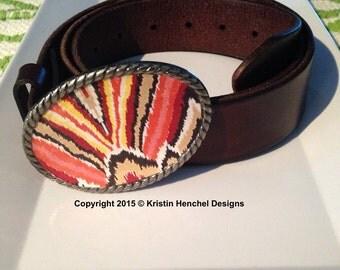 Kristin Henchel belt buckle - brown, orange, yellow, red and tan ikat design