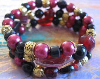 Red, Black and Gold Beaded Bracelet on Gold Tone Memory Wire