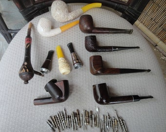 Tobacco items Pipes cleaners cigar holders and more......  1930s-70s estate lot of many