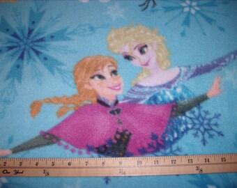 1.5 yards-Frozen fleece/sisters ice skating badges toss-Disney/Pixar