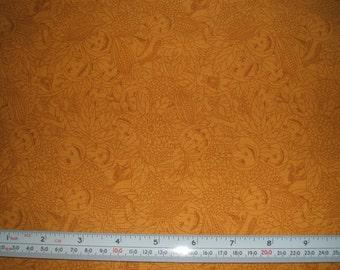Pumpkin Faces on Corn Coloured Cotton x one metre