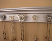 Hundreds of styles and colors to choose from. Jewelry organizer. This necklace holder wall rack features rhinestone center 5 knobs total 15""