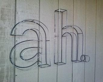 Letter set lower case 20 inch tall spell ah.