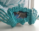 Miniature blue skeleton picture frame