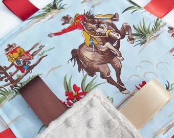Taggie Blanket in Barn Dandy's cowboys cotton design backed in Latte minky - Baby Boy Gift Idea