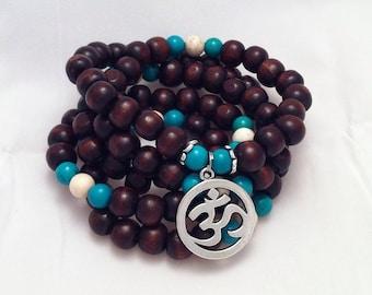 Yogi-inspired 108 wood bead mala meditation bracelet necklace with turquoise and om charm