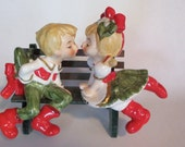 Vintage Lefton kissing boy and girl sitting on bench