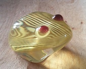Lucite yellow frog with white stripes