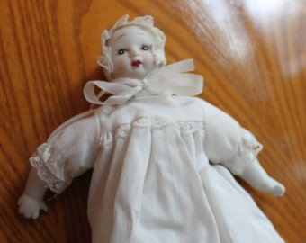 Antique Porcelain Baby Doll with White Dress