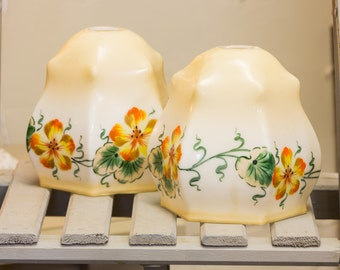 A pair of Vintage Glass Shades, very pretty colours with green, orange and yellow, flower pattern,  cool modern, retro chic