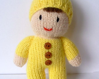Cute, handknitted baby doll