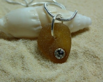 Drilled brown sea glass necklace with clear Swarovski crystal rhinestone and sterling silver chain
