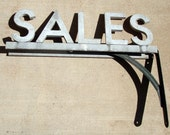 All Original Vintage Cast Aluminum Sale Store Display Outdoor Sign on Brackets Ready to Hang Spanjer Bros Chicago Nice Piece