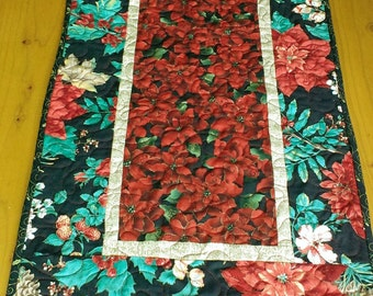 Handmade quilted Christmas poinsettia table runner reverses to fun holiday decor