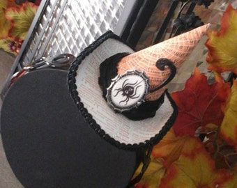 Mini witch hat on headband,  spider decor on front black  flowers on back great piece ready to wear