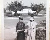 Vintage Mid Century Modern Halloween Snapshot of two children in Halloween Costume Cowboy and Indian
